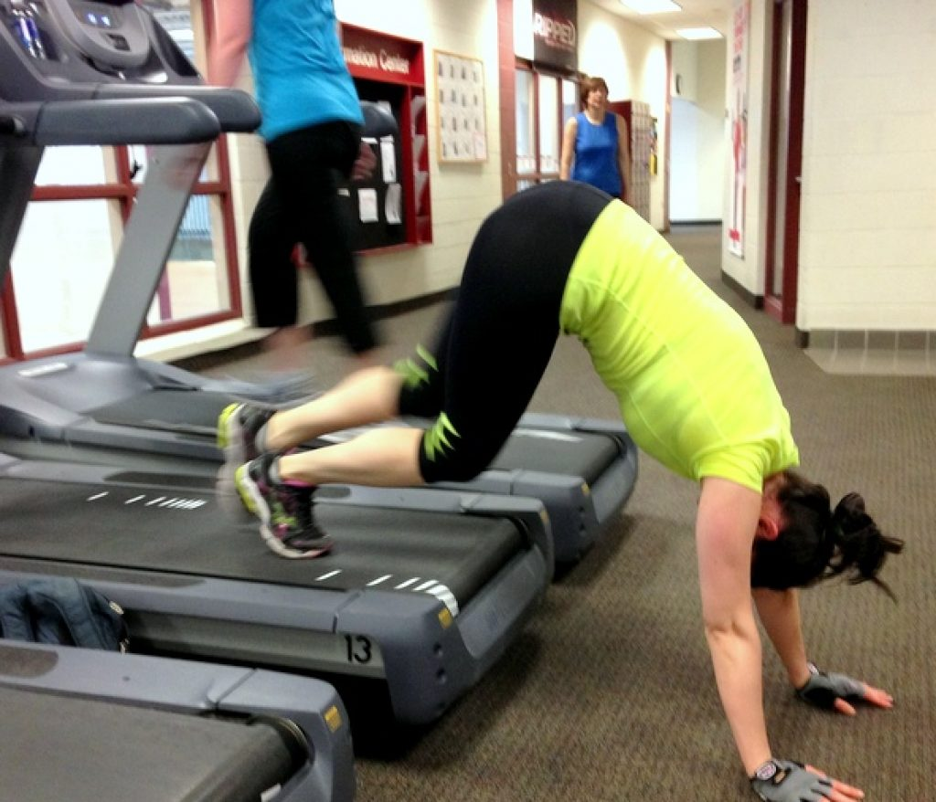 Girl upside down on a treadmill